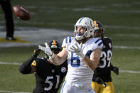 Indianapolis Colts tight end Jack Doyle (84) makes a catch in front of Pittsburgh Steelers inside linebacker Avery Williamson (51) and free safety Minkah Fitzpatrick (39) during the first half of an NFL football game, Sunday, Dec. 27, 2020, in Pittsburgh. (AP Photo/Don Wright)