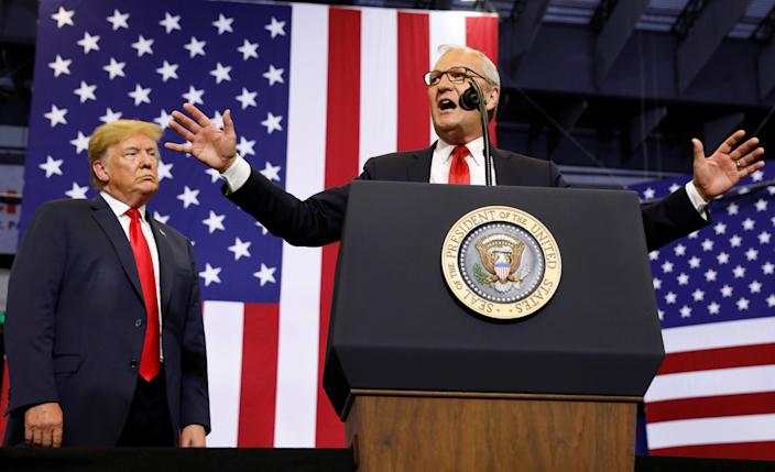 President Trump listens at a rally in support of Rep. Kevin Cramer, right, in his run for the Senate in Fargo, N.D., June 27, 2018. (Photo: Kevin Lamarque/Reuters)