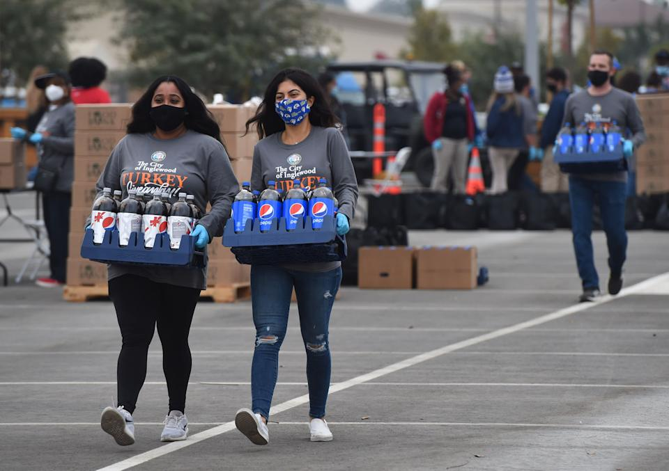 """INGLEWOOD, CA - NOVEMBER 23: L-R Jenee Galindo and Jiana Jaber, Rams employees volunteering during the SoFi Stadium and Hollywood Park Annual City of Inglewood Thanksgiving Turkey Drive""""nin Inglewood on Monday, November 23, 2020. (Photo by Brittany Murray/MediaNews Group/Long Beach Press-Telegram via Getty Images)"""