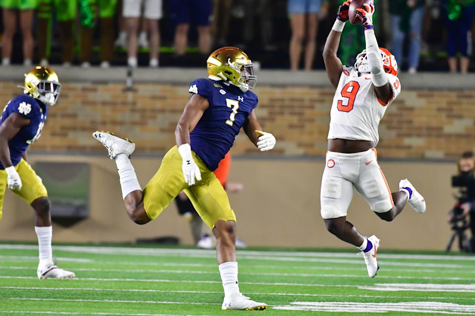 SOUTH BEND, INDIANA - NOVEMBER 07: Running back Travis Etienne #9 of the Clemson Tigers catches a pass as defensive lineman Isaiah Foskey #7 of the Notre Dame Fighting Irish defends in the third quarter at Notre Dame Stadium on November 7, 2020 in South Bend, Indiana. (Photo by Matt Cashore-Pool/Getty Images)