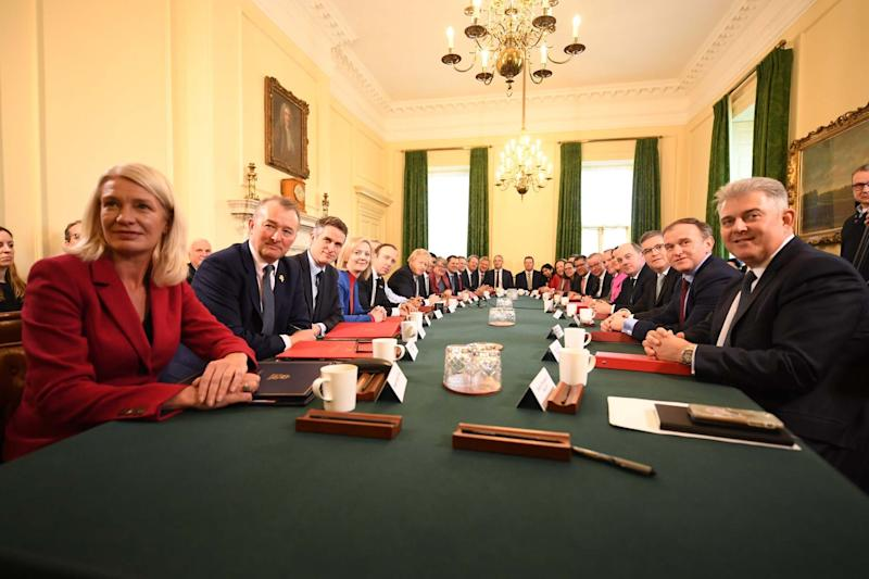First meeting: The new Cabinet gathered in Downing Street today (Jeremy Selwyn)