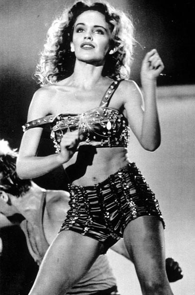 <b>Kylie performing in Tokyo, 1985</b><br><br>The singer wowed the crowds in Japan in this embellished hotpants and bralet combo, predicting the trend way back in the 80s.
