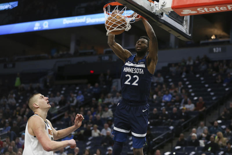 Minnesota Timberwolves' Andrew Wiggins dunks the ball against the Denver Nuggets in the first half of an NBA basketball game Monday, Jan. 20, 2020, in Minneapolis. (AP Photo/Stacy Bengs)