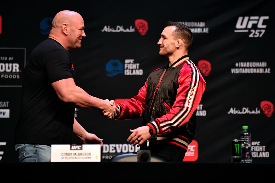 ABU DHABI, UNITED ARAB EMIRATES - JANUARY 21:  (R-L) Michael Chandler shakes hands with UFC President Dana White during the UFC 257 press conference event inside Etihad Arena on UFC Fight Island on January 21, 2021 in Yas Island, Abu Dhabi, United Arab Emirates. (Photo by Jeff Bottari/Zuffa LLC via Getty Images)