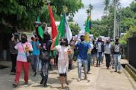 Protesters take part in a demonstration against the military coup in Dawei, Myanmar
