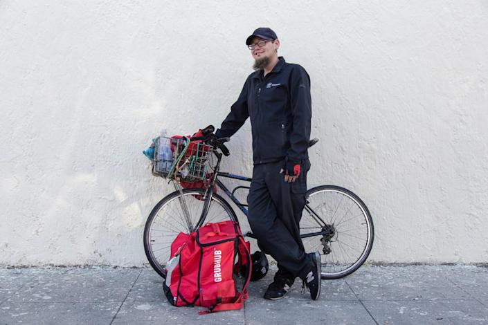 Justin Zemlyansky continues to work as a bike courier for food delivery apps.