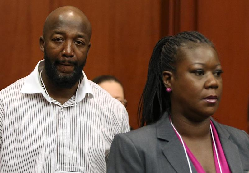 Trayvon Martin's parents, Tracy Martin, left, and Sybrina Fulton, arrive in court during George Zimmerman's trial in Seminole circuit court in Sanford, Fla., Friday, June 14, 2013. Zimmerman has been charged with second-degree murder for the 2012 shooting death of Trayvon Martin.(AP Photo/Orlando Sentinel, Gary W. Green/Pool)
