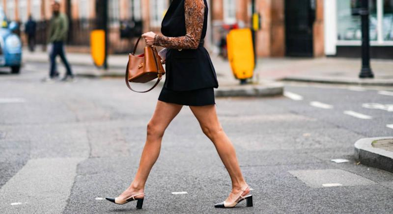 Woman walking in beige and black slingback heels [Photo: Getty]