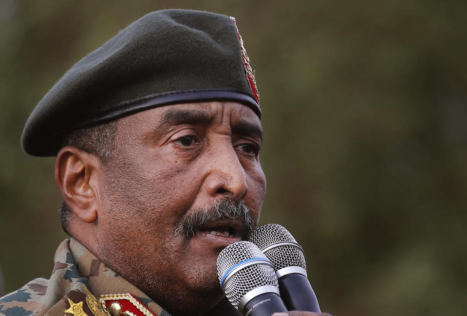 FILE - Sudanese Gen. Abdel-Fattah Burhan speaks during a military-backed rally in Omdurman district, west of Khartoum, Sudan, Saturday, June 29, 2019. Sudan's leader said Monday, Oct. 26, 2020 that the decision to normalize ties with Israel was an incentive for President Donald Trump's administration to end Sudan's international pariah status. Gen. Abdel-Fattah Burhan, head of the ruling sovereign council, told state television that without the deal Sudan would have had to wait until deep into next year to be removed from the U.S.'s list of state sponsors of terrorism. (AP Photo/Hussein Malla, file)