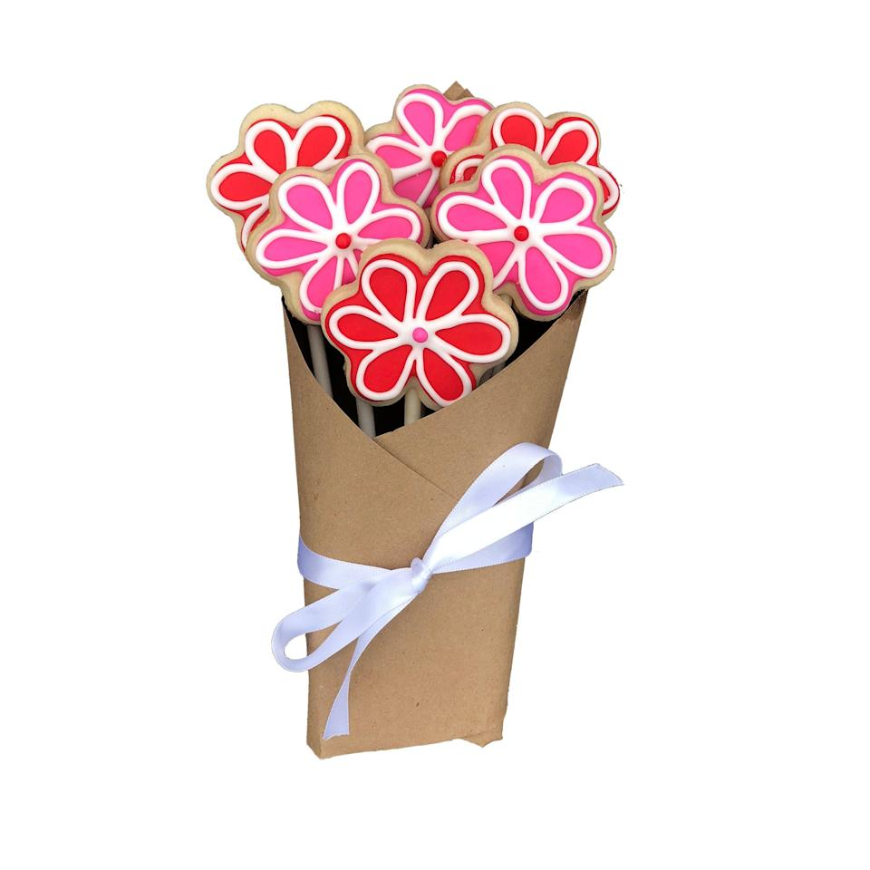 """<strong><h3>Sugar Cookie Bouquet</h3></strong><br>At first glance, this pastel bouquet resembles your ordinary floral arrangement — but after closer inspection, its sweet frosted-petal and sugary-cookie nature become apparent.<br><br><strong>FlowerPowerCookies</strong> Valentine's Day Sugar Cookie Bouquet, $, available at <a href=""""https://go.skimresources.com/?id=30283X879131&url=https%3A%2F%2Fwww.etsy.com%2Flisting%2F663309668%2Fvalentines-day-sugar-cookie-bouquet"""" rel=""""nofollow noopener"""" target=""""_blank"""" data-ylk=""""slk:Etsy"""" class=""""link rapid-noclick-resp"""">Etsy</a>"""