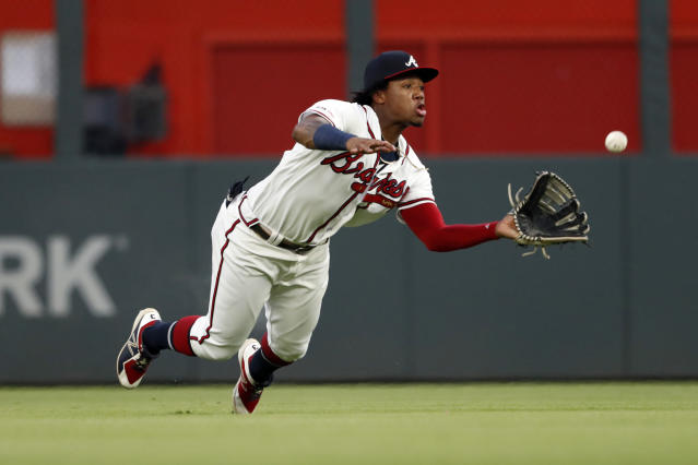 Atlanta Braves center fielder Ronald Acuna Jr. dives to catch a fly ball by Los Angeles Dodgers' Corey Seager with the bases loaded for the final out in the second inning of a baseball game Saturday, Aug. 17, 2019, in Atlanta. (AP Photo/John Bazemore)