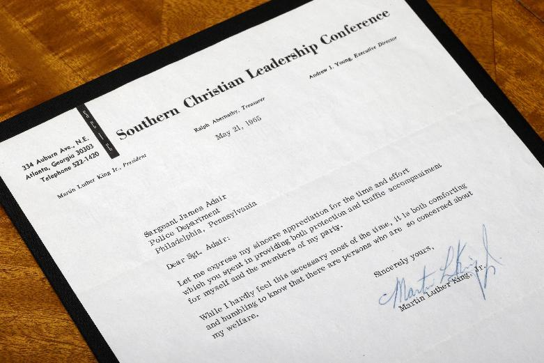 A 1965 one-page typewritten letter signed by Martin Luther King Jr., is displayed Wednesday, April 3, 2013, near Philadelphia. The Raab Collection, a dealer of rare historic documents is selling the letter from Martin Luther King Jr. to Philadelphia police officer Sgt. James Adair who was assigned to protect King, expressing gratitude for the officer's concerns and minimizing his own worries for his personal safety. (AP Photo/Matt Rourke)