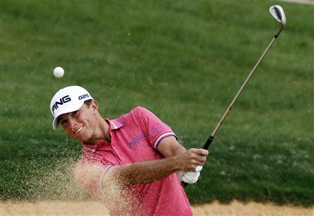 Luke Guthrie of U.S. hits out of a sand trap on the 7th hole during the BMW Masters 2013 golf tournament at Lake Malaren Golf Club in Shanghai October 25, 2013. REUTERS/Carlos Barria