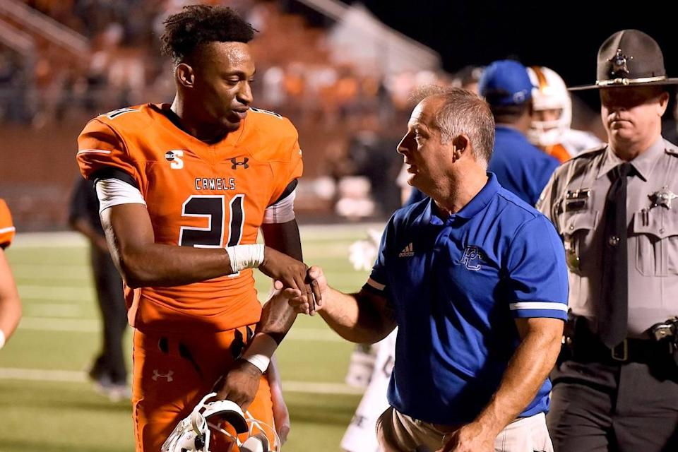 Presbyterian head football coach Kevin Kelly congratulates Campbell running back Michael Jamerson (21) after their victory.r The Presbyterian Blue Hose and the Campbell Fighting Camels met in a non-conference football game in Buies Creek, N.C. on September 18, 2021.