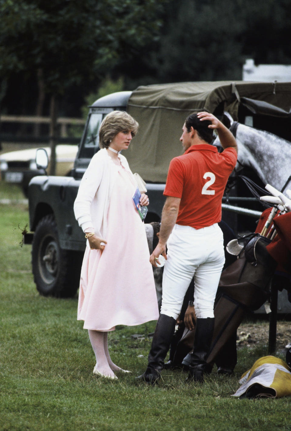 <p>Diana, Princess of Wales, wears a light pink dress and white cardigan with Prince Charles, Prince of Wales, at a polo event at Windsor Great Park in June 1982, in Windsor. (Photo: Getty Images) </p>
