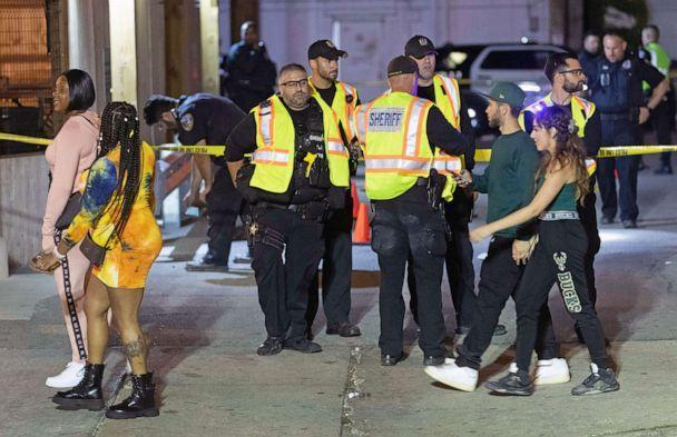 PHOTO: Milwaukee County Sheriff's deputies and Milwaukee Police officers work at a shooting scene at Elwood's Liquor which occurred after the NBA Finals game at Fiserv Forum between the Milwaukee Bucks and the Phoenix Suns on July 21, 2021, in Milwaukee. (Mark Hoffman/Milwaukee Journal Sentinel via USA Today Network)