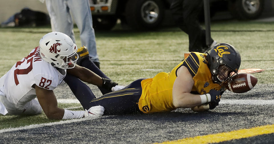 California's Gavin Reinwald, right, scores a touchdown past Washington State's Travion Brown (82) during the first half of an NCAA college football game Saturday, Nov. 9, 2019, in Berkeley, Calif. (AP Photo/Ben Margot)