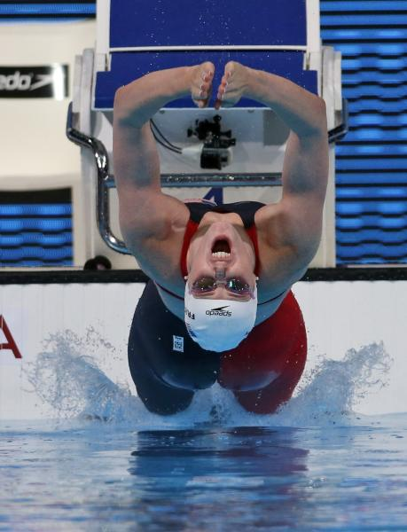 Missy Franklin of the United States starts a Women's 100m backstroke heat at the FINA Swimming World Championships in Barcelona, Spain, Monday, July 29, 2013. (AP Photo/Michael Sohn)