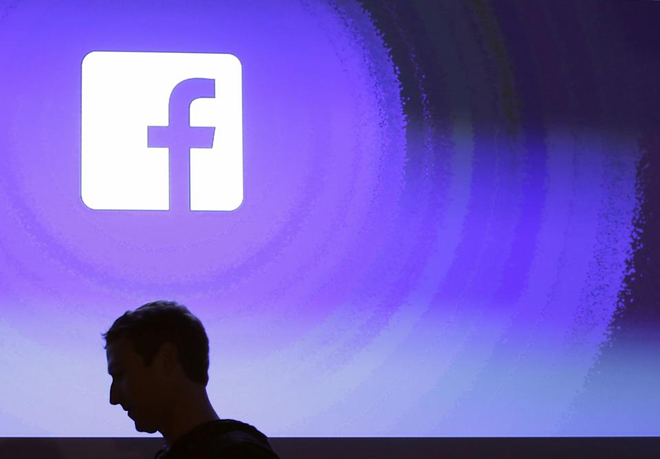 FILE - In this April 4, 2013 file photo, Facebook CEO Mark Zuckerberg walks at the company's headquarters in Menlo Park, Calif. Facebook has dropped 13.5 percent after allegations a political consulting firm working for the Trump campaign got data inappropriately from millions of Facebook users. On Monday, March 26, 2018, the Federal Trade Commission said it's investigating the social media giant's privacy practices and legislators in the U.S. and the U.K. have demanded answers and called for inquiries. (AP Photo/Marcio Jose Sanchez, File)