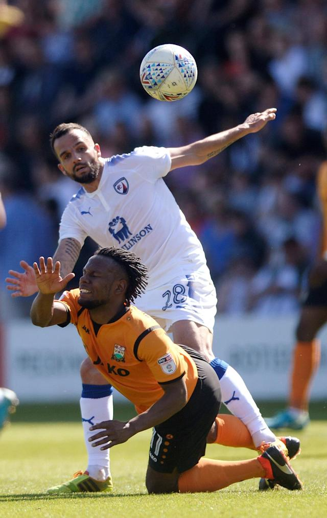 "Soccer Football - League Two - Barnet vs Chesterfield - The Hive, London, Britain - May 5, 2018 Barnet's Shaquile Coulthirst in action with Chesterfield's Robbie Weir Action Images/Adam Holt EDITORIAL USE ONLY. No use with unauthorized audio, video, data, fixture lists, club/league logos or ""live"" services. Online in-match use limited to 75 images, no video emulation. No use in betting, games or single club/league/player publications. Please contact your account representative for further details."