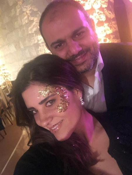 This December 31, 2018 photo provided by Soha Saade,, shows Soha and her husband Jihad during a New Year's celebration, in Jounieh, north of Beirut, Lebanon. Jihad died in his wife's hands while staying with their sick six-year-old daughter at a hospital in a massive explosion that devastated Beirut Tuesday, Aug. 4, 2020. (Soha Saade via AP)