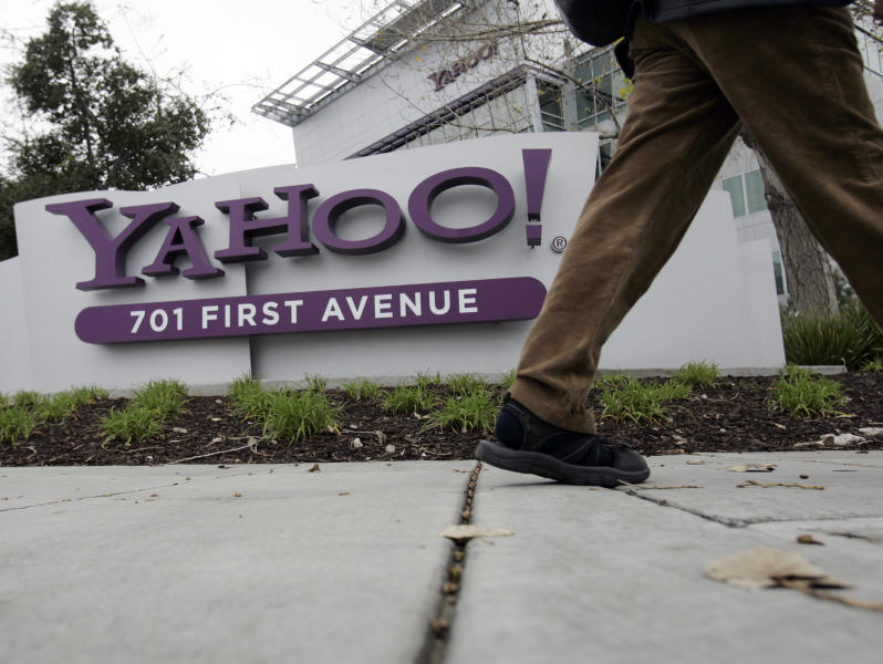 FILE - This Jan. 29, 2008 file photo shows a Yahoo worker walking into Yahoo headquarters in Sunnyvale, Calif. As Marissa Mayer goes about her CEO business of saving Yahoo, which now involves a ban on working from home, a new study shows a significant jump in the number of U.S. employers offering flex and other quality-of-life perks. (AP Photo/Paul Sakuma, file)