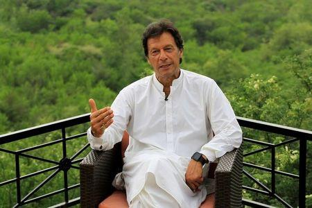 Imran Khan, chairman of the Pakistan Tehreek-e-Insaf (PTI) political party, speaks with a Reuters correspondent during an interview at his home in the hills of Bani Gala, Islamabad