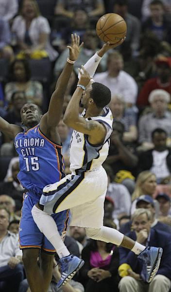 Memphis Grizzlies' Mike Conley, right, shoots against Oklahoma City Thunder point guard Reggie Jackson (15) in the first half of Game 4 in a Western Conference semifinal NBA basketball playoff series in Memphis, Tenn., Monday, May 13, 2013. (AP Photo/Danny Johnston)