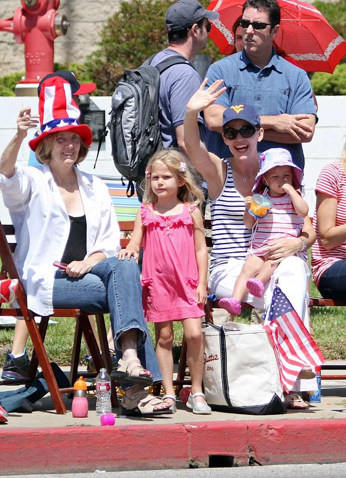 "Meanwhile, Matt's ""Ghost of Girlfriends Past"" leading lady Jennifer Garner, hubby Ben Affleck, and daughters Violet and Seraphina enjoyed a parade in LA. Jean Baptiste Lacroix/<a href=""http://www.wireimage.com"" target=""new"">WireImage.com</a> - July 4, 2010"