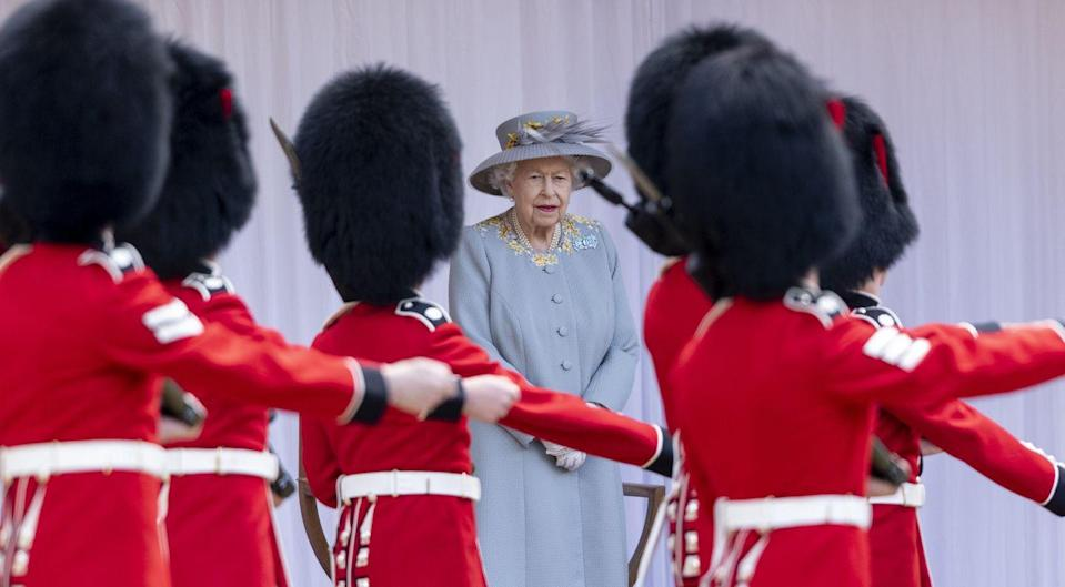 <p>For today's celebration, the Queen opted for a pale grey-blue coat with yellow details by her dresser Angela Kelly, which she paired with a matching hat, white gloves, and an aquamarine brooch. </p>