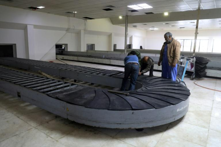 Workers at the Libyan capital's Mitiga airport