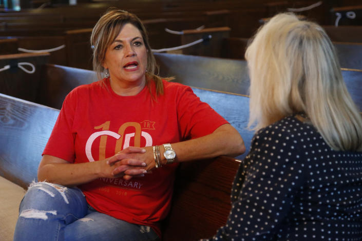 Teresa Stanfield, left, the Oklahoma field director with Virginia-based Prison Fellowship, talks with Teresa Peden, pastor of recovery at Crossing Community Church, Tuesday, Aug. 11, 2020, at the church in Oklahoma City. Normally, Stanfield is behind bars, talking with inmates about how she changed the course of her troubled life. The coronavirus has forced her out of prisons. For the time being, Stanfield is videotaping her message. (AP Photo/Sue Ogrocki)