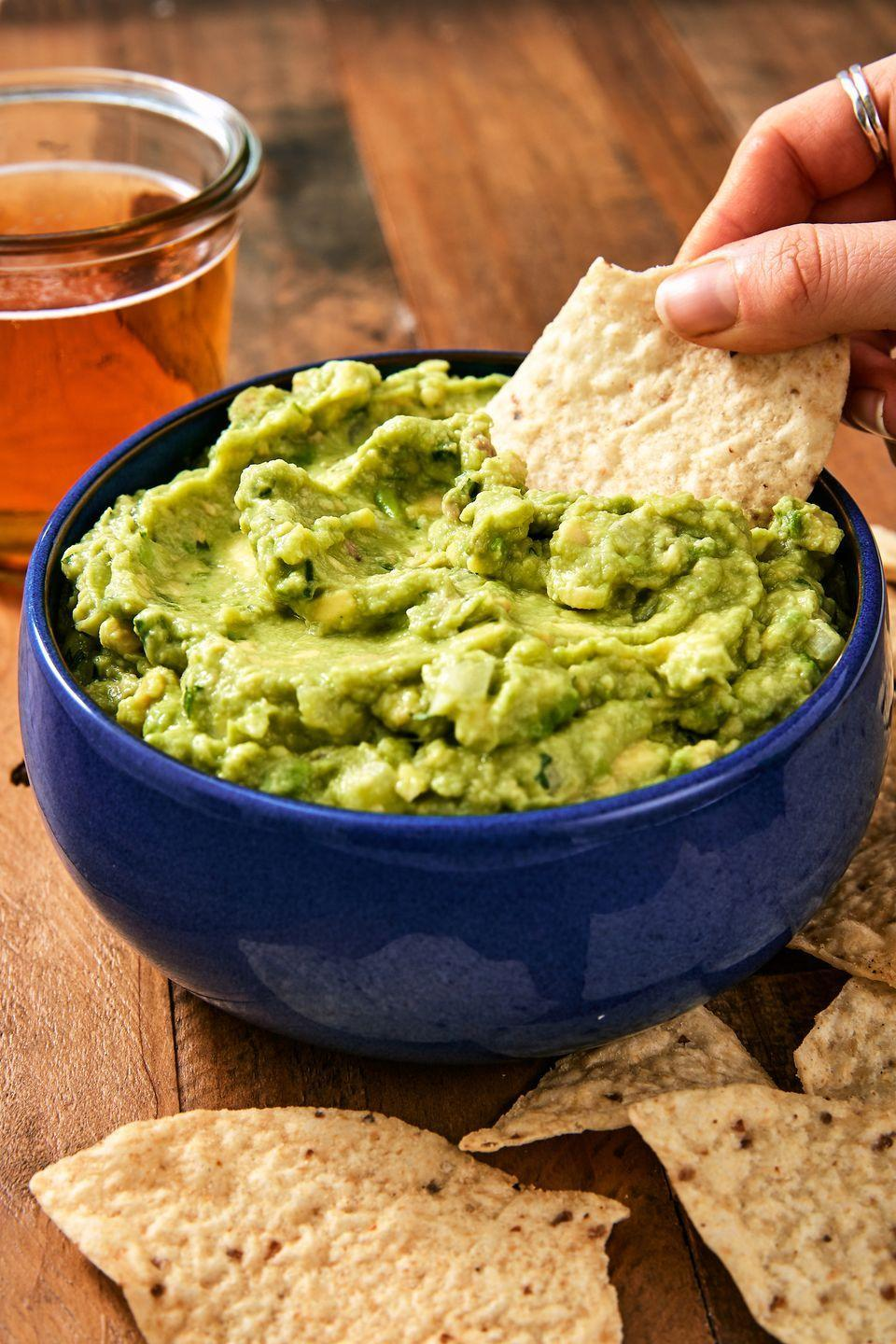 """<p>Serving guacamole at your summer get-togethers is non-negotiable.</p><p>Get the recipe from <a href=""""https://www.delish.com/cooking/recipe-ideas/recipes/a45570/best-ever-guacamole-recipe/"""" rel=""""nofollow noopener"""" target=""""_blank"""" data-ylk=""""slk:Delish"""" class=""""link rapid-noclick-resp"""">Delish</a>.</p>"""