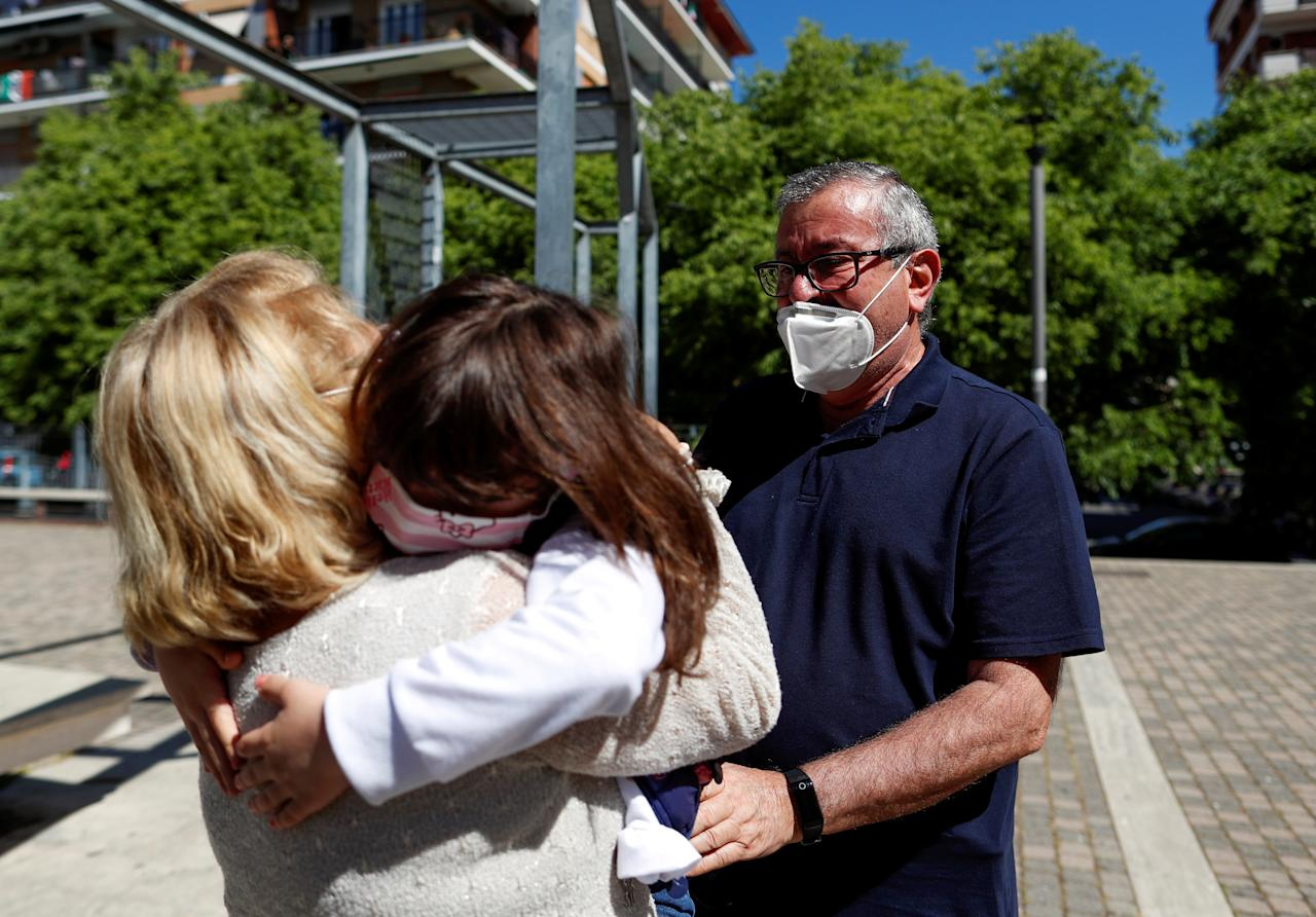 Domenico di Massa and Mariantonia Gangemi embrace their granddaughter Cecilia for the first time in two months after Italy allowed families to see each other again as the country begins a staged end to a nationwide lockdown due to a spread of the coronavirus disease (COVID-19), in Rome, Italy, May 4, 2020. REUTERS/Yara Nardi     TPX IMAGES OF THE DAY