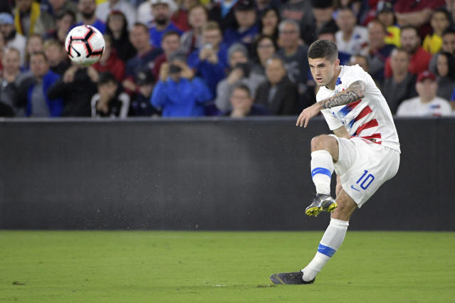 United States midfielder Christian Pulisic (10) passes the ball during the first half of an international friendly soccer match against Ecuador, Thursday, March 21, 2019, in Orlando, Fla. (AP Photo/Phelan M. Ebenhack)