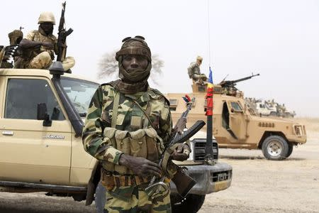 Chadian soldier poses for picture at front line during battle against insurgent group Boko Haram in Gambaru