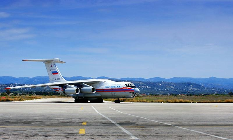 A picture released by the official Syrian Arab News Agency on April 15, 2014 reportedly shows a Russian airplane carrying 15 tons of assorted types of aid at the Bassel al-Assad international airport in Syria's Mediterranean port city of Latakia (AFP Photo/)