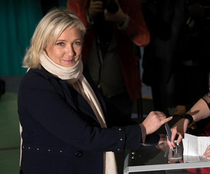 French far-right National Front leader Marine Le Pen casts her ballot during regional elections in the Nord Picardie region, on December 6, 2015 (AFP Photo/Denis Charlet)