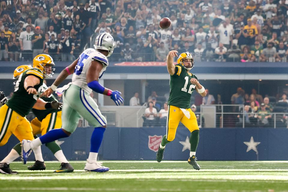 ARLINGTON, TX - OCTOBER 08: Green Bay Packers quarterback Aaron Rodgers (12) makes a pass while scrambling during the football game between the Green Bay Packers and Dallas Cowboys on October 8, 2017 at AT&T Stadium in Arlington, TX.  (Photo by Andrew Dieb/Icon Sportswire via Getty Images)