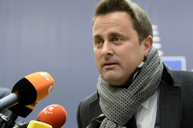 Luxembourg Prime Minister Xavier Bettel addresses journalists at an EU leaders summit in Brussels on October 20, 2016