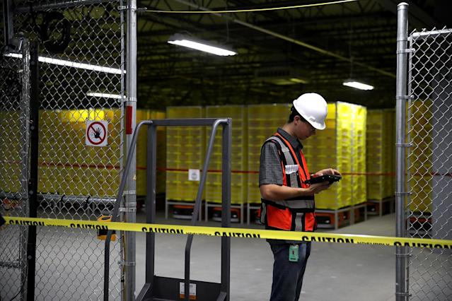 A worker at an Amazon fulfillment center in Sacramento, California. (Photo by Justin Sullivan/Getty Images)