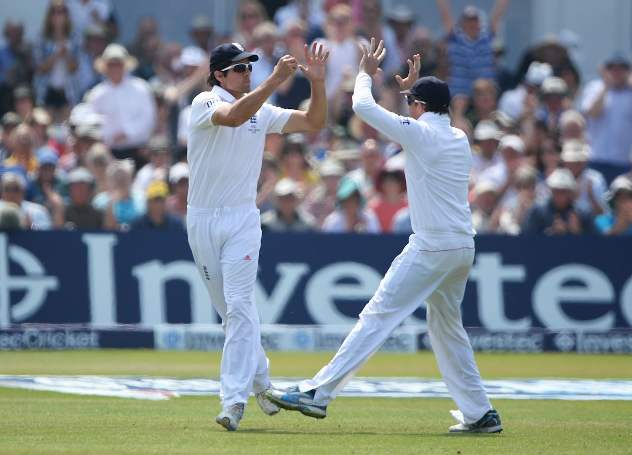 NOTTINGHAM, ENGLAND - JULY 14: Alastair Cook (L) of England celebrates the catch to dismiss Mitchell Starc of Australia with Graeme Swann off the bowling of James Anderson during day five of the 1st Investec Ashes Test match between England and Australia at Trent Bridge Cricket Ground on July 14, 2013 in Nottingham, England.  (Photo by Gareth Copley/Getty Images)