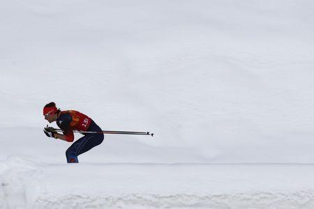 Russia's Maxim Vylegzhanin skis during the men's cross-country team sprint classic final at the Sochi 2014 Winter Olympics February 19, 2014. REUTERS/Michael Dalder