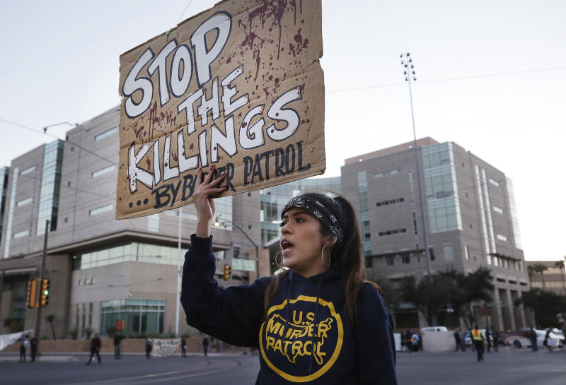 FILE - In this Nov. 21, 2018, file photo, a protester stands in front of the federal courthouse in response to a jury finding U.S. Border Patrol agent Lonnie Swartz not guilty of involuntary manslaughter in the cross-border shooting death of Mexican teen Jose Antonio Elena Rodriguez in Tucson, Ariz. Federal prosecutors on Thursday, Dec. 6, 2018, said they would not pursue another trial against Border Patrol agent Lonnie Swartz, who was twice acquitted. (Mike Christy/Arizona Daily Star via AP, File)/Arizona Daily Star via AP)