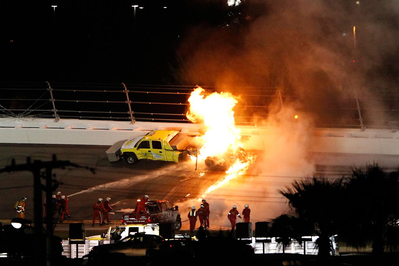 DAYTONA BEACH, FL - FEBRUARY 27:  Safety workers try to extinguish a fire from a jet dryer after being hit by Juan Pablo Montoya, driver of the #42 Target Chevrolet, under caution during the NASCAR Sprint Cup Series Daytona 500 at Daytona International Speedway on February 27, 2012 in Daytona Beach, Florida.  (Photo by Streeter Lecka/Getty Images)