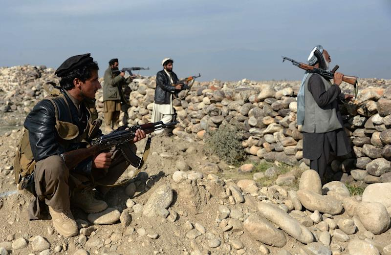 Anti-(IS) armed Afghan militia forces keep watch during ongoing clashes with Islamic state (IS) fighters in Achin district of Nangarhar province on December 27, 2015