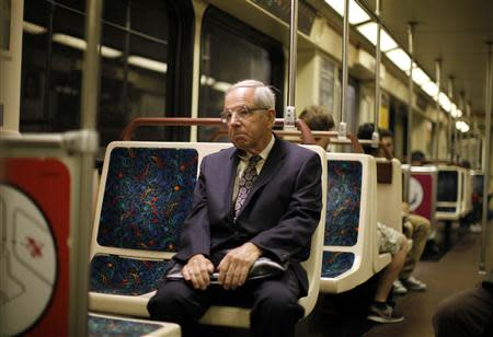 Shareholder activist John Chevedden, 67, rides the subway to the DreamWorks Animation SKG Inc stockholder meeting in Hollywood, California May 29, 2013. For use with special report ACTIVIST-CHEVEDDEN/ REUTERS/Lucy Nicholson