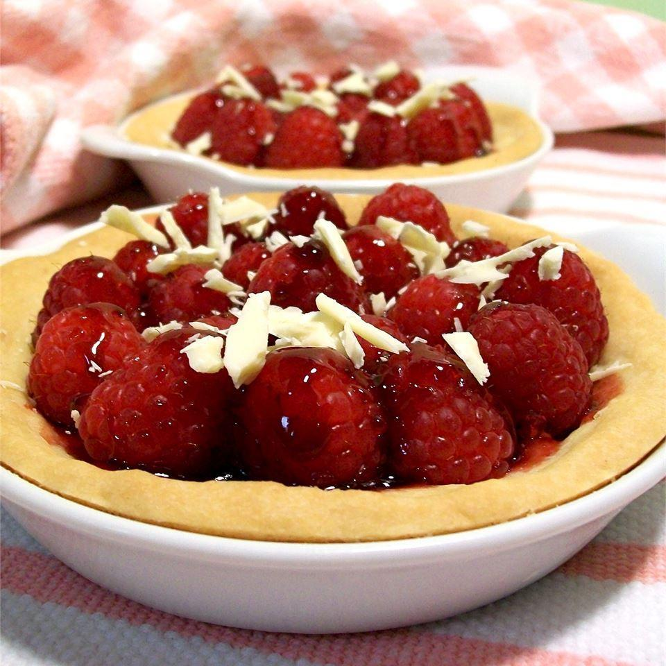 <p>The only labor that goes into this easy dessert is making the crust, and that's hardly anything at all. The filling is just fresh raspberries and warm raspberry jam. You can make one big tart or a few small ones, as shown. Grate a little white chocolate over the top as a simple embellishment.</p>