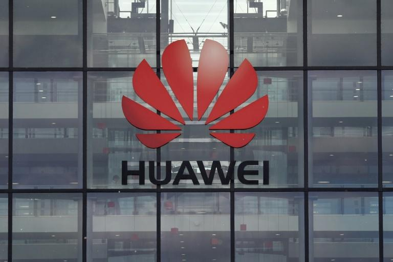 A US-China trade pact leaves out questions about what to do about Huawei, the tech giant Washington accuses of supporting espionage (AFP Photo/Adrian DENNIS)