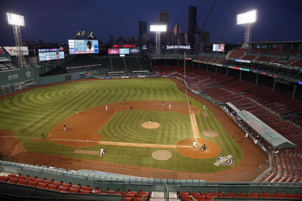 The Baltimore Orioles play against the Boston Red Sox during the third inning of an opening day baseball game at Fenway Park, Friday, July 24, 2020, in Boston. (AP Photo/Michael Dwyer)